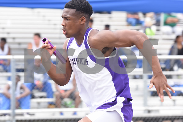 Lufkin's Malik Jackson competes in the 400 meter relay Thursday at the 15/16-5A Track and Field Championships held in Whitehouse Thursday April 21, 2016.  (Sarah A. Miller/Tyler Morning Telegraph)