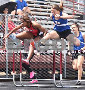Marshall's Kendall Drewery, left places second and Sulphur Springs' freshman Abbi Baier, right, takes first place in the 100 meter hurdles Thursday at the 15/16-5A Track and Field Championships held in Whitehouse Thursday April 21, 2016.  (Sarah A. Miller/Tyler Morning Telegraph)
