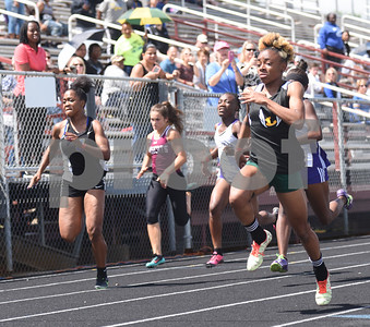 Longview junior Deja Moore wins the 100 meter dash Thursday at the 15/16-5A Track and Field Championships held in Whitehouse Thursday April 21, 2016.  (Sarah A. Miller/Tyler Morning Telegraph)