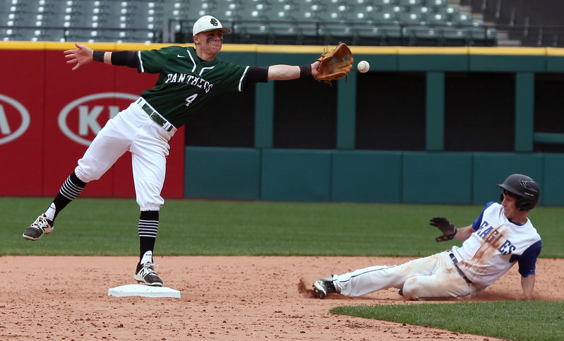 Elyria Catholic second baseman Ryan Strittmather reaches for the ball as Hubbard's Ryan Love slides in safely. Randy Meyers -- The Morning Journal