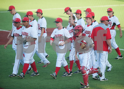 Robert E. Lee baseball players switch positions after the first inning in their game against North Mesquite Friday night at Mike Carter Field.  (Sarah A. Miller/Tyler Morning Telegraph)