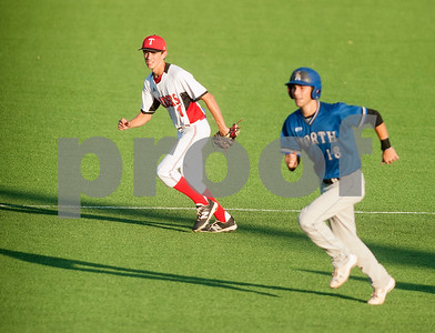 Robert E. Lee's (1) Trevor Doke and North Mesquite's (18) Andrew Tucker watch the batter from second base during their game Friday night at Mike Carter Field.  (Sarah A. Miller/Tyler Morning Telegraph)