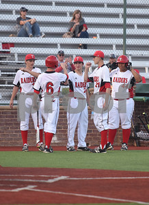 Robert E. Lee's (6) Kade Kenner is greeted by his teammates after scoring a run in their game against North Mesquite Friday night at Mike Carter Field.  (Sarah A. Miller/Tyler Morning Telegraph)