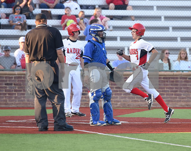 Robert E. Lee's (1) Trevor Doke runs in to home plate as the Raiders play North Mesquite Friday night at Mike Carter Field.  (Sarah A. Miller/Tyler Morning Telegraph)