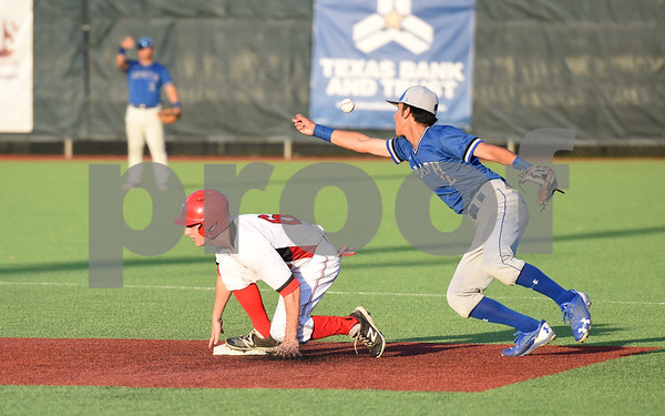 Robert E. Lee's (6) Kade Kenner is safe as the ball slips away from North Mesquite's (2) Arturo Gaytan during their game Friday night at Mike Carter Field.  (Sarah A. Miller/Tyler Morning Telegraph)