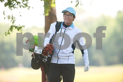 Ethan Lee of Lewisville carries his bag from the 14th green to the 15th tee during the Azalea Trail Junior Golf Classic held at Hollytree Country Club in Tyler Saturday April 2, 2016. The classic had 141 golfers.  (Sarah A. Miller/Tyler Morning Telegraph)
