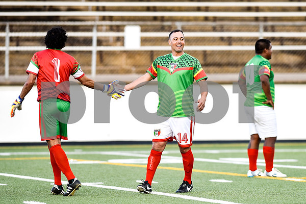 Mexico's Tirzo Carpizo (1) and Daniel Hernández (14) high five during a soccer game at Christus Trinity Mother Frances Rose Stadium in Tyler, Texas, on Sunday, April 2, 2017. Mexico beat Honduras 3-2. (Chelsea Purgahn/Tyler Morning Telegraph)