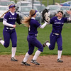 Keystone right fielder Marlie McNulty, right, celebrates with her teamates after making a great over-the-shoulder catch. Randy Meyers -- The Morning Journal