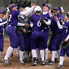Madi Cendrosky of Keystone is mobbed by her teamates at home plate after hitting a home run against Pittsford Sutherland. Randy Meyers -- The Morning Journal