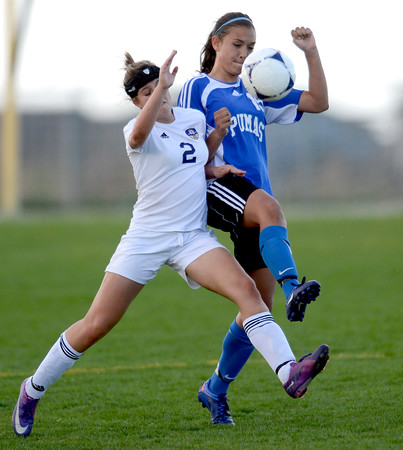 Holy Family's Taylor Johnson (left) and Peak to Peak's Ivy Devries collide going for the ball during their soccer game at Holy Family in Broomfield, Colorado April 23, 2012. CAMERA/MARK LEFFINGWELL