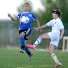 Peak to Peak's Galen Roda (left) and Holy Family's Maddie Kuzik (right) go for the ball during their soccer game at Holy Family in Broomfield, Colorado April 23, 2012. CAMERA/MARK LEFFINGWELL