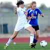 Holy Family's Kendall Russell (left) collides with Peak to Peak's Kaja Lamvik (right) going for the ball during their soccer game at Holy Family in Broomfield, Colorado April 23, 2012. CAMERA/MARK LEFFINGWELL