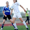Holy Family's Ashley Burk (right) knocks the ball down in front of Peak to Peak's Belle Morel (left) during their soccer game at Holy Family in Broomfield, Colorado April 23, 2012. CAMERA/MARK LEFFINGWELL