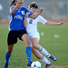 Peak to Peak's Ivy Devries (left) and Holy Family's Taylor Johnson collide going for the ball during their soccer game at Holy Family in Broomfield, Colorado April 23, 2012. CAMERA/MARK LEFFINGWELL