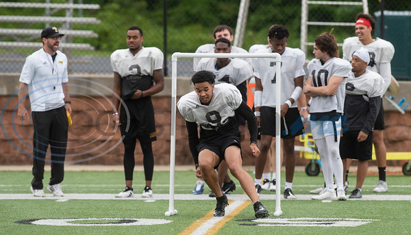 The Tyler Junior College Apache football team had a rainy start to their practice on Wednesday April 24, 2019.  (Sarah A. Miller/Tyler Morning Telegraph)