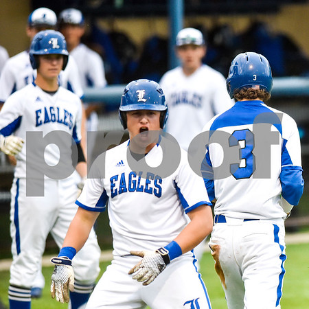 Teammates celebrate after Jamey Richey (3) made a run during a high school baseball game at Lindale High School in Lindale, Texas, on Tuesday, April 25, 2017. (Chelsea Purgahn/Tyler Morning Telegraph)