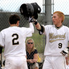 Monarch's Cole Maltese (right) knocks helmets with Greg Przedpelski (left) Boulder's during their baseball game at Monarch High School in Louisville, Colorado April 26, 2012. BOULDER DAILY CAMERA/MARK LEFFINGWELL