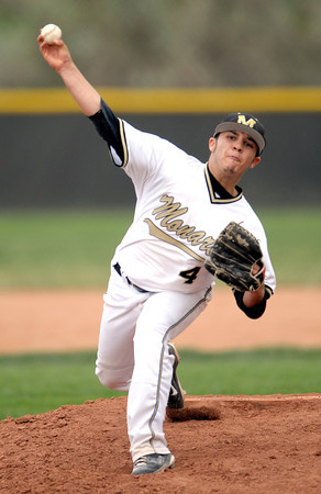 Monarch's Alex Blazon pitches against Boulder during their baseball game at Monarch High School in Louisville, Colorado April 26, 2012. BOULDER DAILY CAMERA/MARK LEFFINGWELL