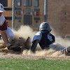 Michael Clark of Lorain steals third base as Owen Jaite of Rocky River misses on the tag. Randy Meyers -- The Morning Journal
