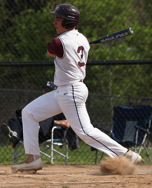 Rocky River's Michael Konrad delivers a base hit against Lorain. Randy Meyers -- The Morning Journal