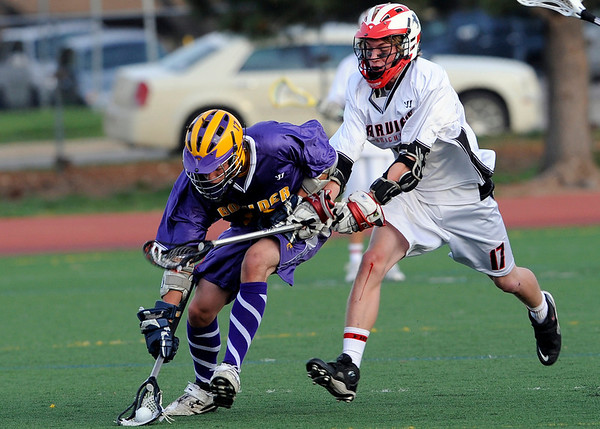 Boulder's Trevor Larson (left) races Fairview's Dylan Cook to the ball during their lacrosse game at Fairview High School in Boulder, Colorado April 27, 2010.  CAMERA/Mark Leffingwell
