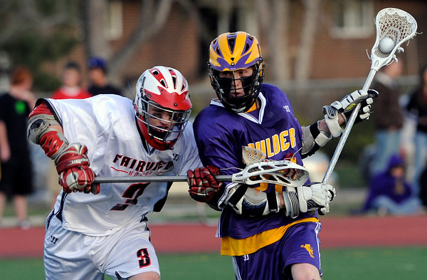 Fairview's Joe Quinn (left) pressures Boulder's Justin Wenzel (right) during their lacrosse game at Fairview High School in Boulder, Colorado April 27, 2010.  CAMERA/Mark Leffingwell
