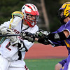Fairview's Austin Ayan (left) tries to get past Boulder's Billy Baumgartner (right) during their lacrosse game at Fairview High School in Boulder, Colorado April 27, 2010.  CAMERA/Mark Leffingwell
