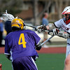 Fairview's Austin Davie (right) takes shot while being pressured by Boulder's AJ Framarini (left) during their lacrosse game at Fairview High School in Boulder, Colorado April 27, 2010.  CAMERA/Mark Leffingwell