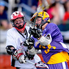 Boulder's Griffin Bohm (right) takes a shot while under pressure from Fairview's Dylan Cook (left) during their lacrosse game at Fairview High School in Boulder, Colorado April 27, 2010.  CAMERA/Mark Leffingwell