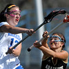 Arapahoe's Margot Cohn (right) steals the ball from Centaurus' Carley Dvorak (left) during their lacrosse game at Centaurus High School in Lafayette, Colorado April 27, 2012. BOULDER DAILY CAMERA/MARK LEFFINGWELL