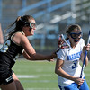 Centaurus' Sarah Brown (right) dodges around Arapahoe's Isley Walker (left) during their lacrosse game at Centaurus High School in Lafayette, Colorado April 27, 2012. BOULDER DAILY CAMERA/MARK LEFFINGWELL