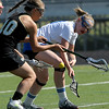 Centaurus' Katherine Burns (right) and Arapahoe's Analise Stein (left) go for a loose ball during their lacrosse game at Centaurus High School in Lafayette, Colorado April 27, 2012. BOULDER DAILY CAMERA/MARK LEFFINGWELL