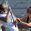 Centaurus' Sarah Brown (left) gets jammed by Arapahoe's Hope Swearingen (right) during their lacrosse game at Centaurus High School in Lafayette, Colorado April 27, 2012. BOULDER DAILY CAMERA/MARK LEFFINGWELL