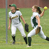 Amherst's Amanda Crisler, right, fields a fly ball to to the fence. Eric Bonzar — The Morning Journal