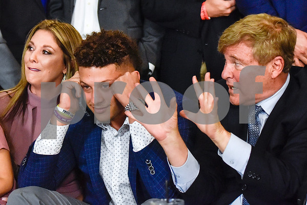 Leigh Steinberg flashes the number 10 with his hands as Patrick Mahomes II talks with the Kansas City Chiefs on the phone during an NFL Draft watch party at Lago del Pino in Tyler, Texas, on Thursday, April 27, 2017. Mahomes II was the tenth overall pick in the first round of the NFL draft for the Kansas City Chiefs after a trade with the Buffalo Bills. (Chelsea Purgahn/Tyler Morning Telegraph)