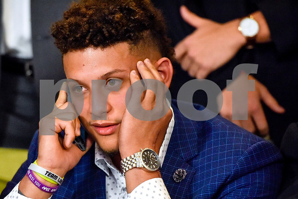 Patrick Mahomes II listens on a call with the Kansas City Chiefs during an NFL Draft watch party at Lago del Pino in Tyler, Texas, on Thursday, April 27, 2017. Mahomes II was the tenth overall pick in the first round of the NFL draft for the Kansas City Chiefs after a trade with the Buffalo Bills. (Chelsea Purgahn/Tyler Morning Telegraph)