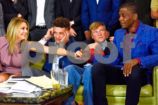Randi Martin reaches out to Pat Mahomes as their son Patrick Mahomes II is on the phone with the Kansas City Chiefs during an NFL Draft watch party at Lago del Pino in Tyler, Texas, on Thursday, April 27, 2017. Mahomes II was the tenth overall pick in the first round of the NFL draft for the Kansas City Chiefs after a trade with the Buffalo Bills. (Chelsea Purgahn/Tyler Morning Telegraph)