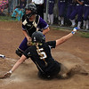 Perry's Nikki Saibene slides into home safely before the tag by Keystone catcher Summer Metcalf. Randy Meyers -- The Morning Journal
