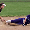 Keystone's Marlie McNulty slides into second base before the tag by Kim Borck of Perry. Randy Meyers -- The Morning Journal