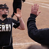 Perry starting pitcher Makenna Durieux gets a high-five from head coach Scott Daugherty. Randy Meyers -- The Morning Journal