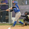 Midview's Hannah Taulbee connects with a pitch. Eric Bonzar — The Morning Journal