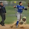 Midview's Hailey Ivan cannot hang on to the ball as Perrysburg's Caitlin Reighard slides into second base. Eric Bonzar — The Morning Journal