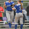 Midview pitcher Marcella McMahon and Ella Leonard (2) celebrate an out. Eric Bonzar — The Morning Journal