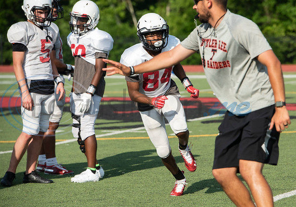 Robert E. Lee High School football receivers coach Colton Traylor runs a drill with his player at the school on Monday April 29, 2019.  (Sarah A. Miller/Tyler Morning Telegraph)