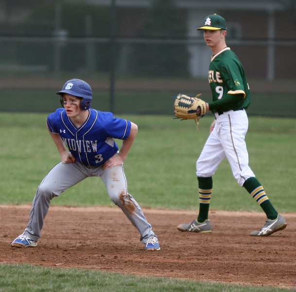 Midview's Cam Honis gets a lead from second base as Amherst shortstop Ryan Glowacki closes in from behind. Randy Meyers -- The Morning Journal