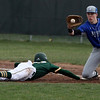 Midview first baseman Owen Hawke looks the ball in as Xavier Moore of Amherst dives back to first. Randy Meyers -- The Morning Journal