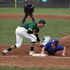 Midview's Cam Honis dives back to first before the tag applied by Amherst first baseman Chad Jones. Randy Meyes -- The Morning Journal
