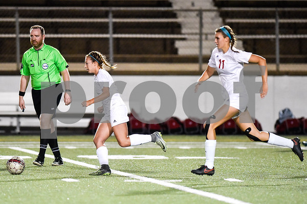 A referee and Kilgore players run down the field during a high school soccer playoff game at Rose Stadium in Tyler, Texas, on Tuesday, April 4, 2017. (Chelsea Purgahn/Tyler Morning Telegraph)