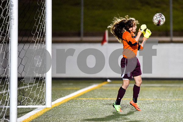 Athens' Makayla Lewis' (0) hair flies in her face as she catches the ball during a high school soccer playoff game at Rose Stadium in Tyler, Texas, on Tuesday, April 4, 2017. (Chelsea Purgahn/Tyler Morning Telegraph)