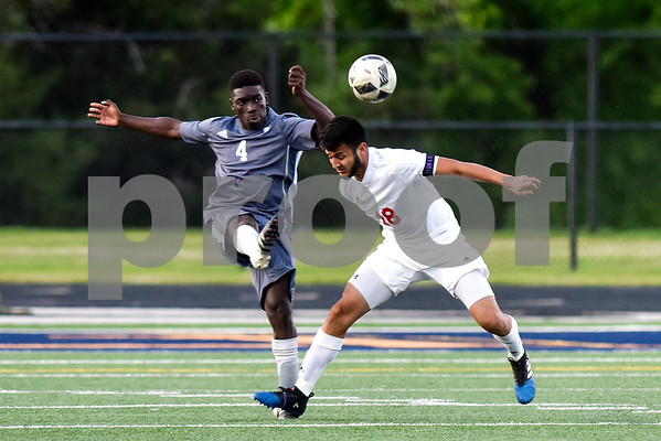 Palestine's David Egbe (4) and Kilgore's Elian Torres (18) jump for the ball during a high school soccer playoff game at Brook Hill Herrington Stadium in Bullard, Texas, on Tuesday, April 4, 2017. (Chelsea Purgahn/Tyler Morning Telegraph)